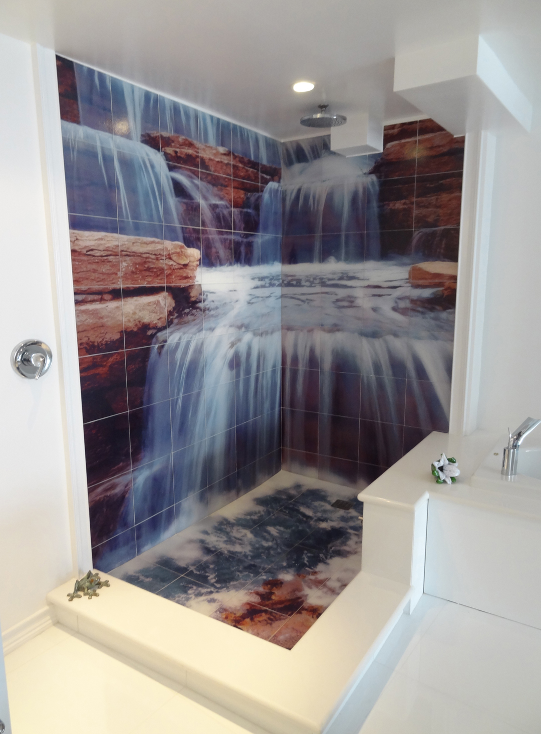 You may have seen pictures elsewhere but we are the manufacturer of these beautiful waterfall shower tile murals we have successfully custom fit many